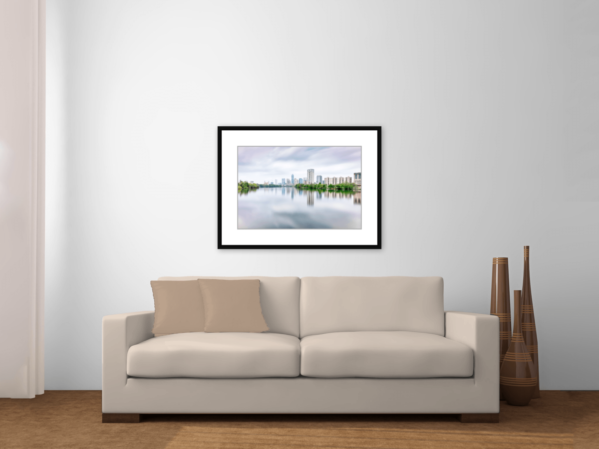 """Austin Skyline Reflected Across Lady Bird Lake"" Framed Color Photography Print Above a Couch"