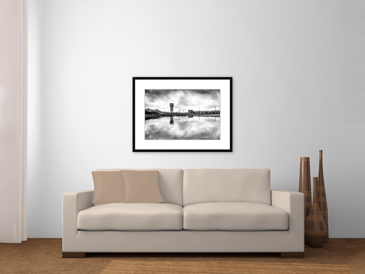 """Mueller Airport Control Tower"" Black and White Framed Photography Print Above a Couch"